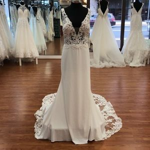 Ivory wedding gown with lace and sequins